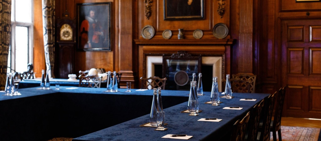 The Court room is set up for a meeting with blue table cloth