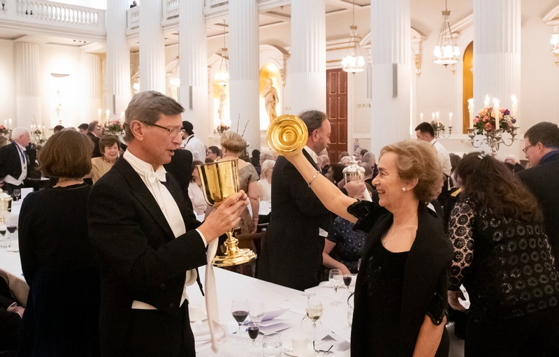 Livery members enjoying the loving cup at a livery dinner