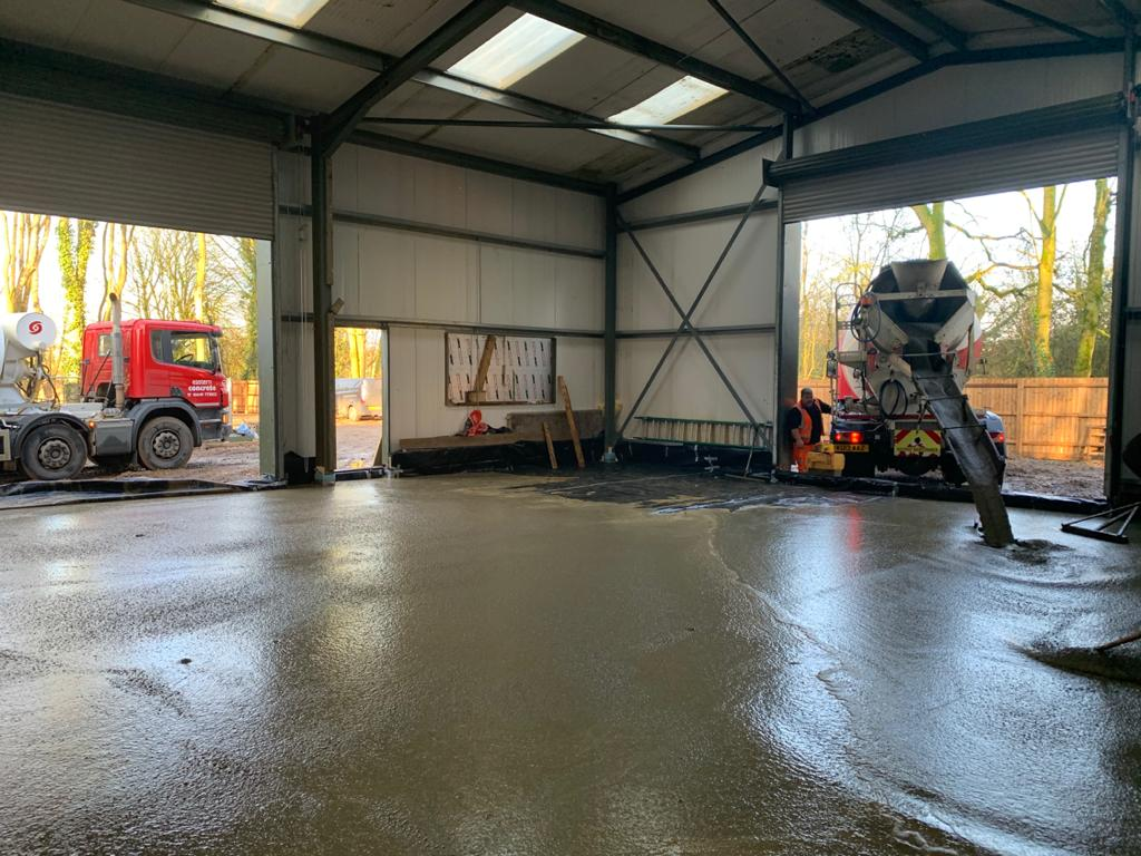 Concrete floor screeding for industrial warehouse