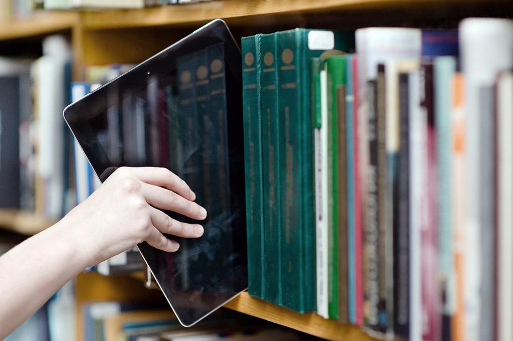 iPad pulled from bookshelf
