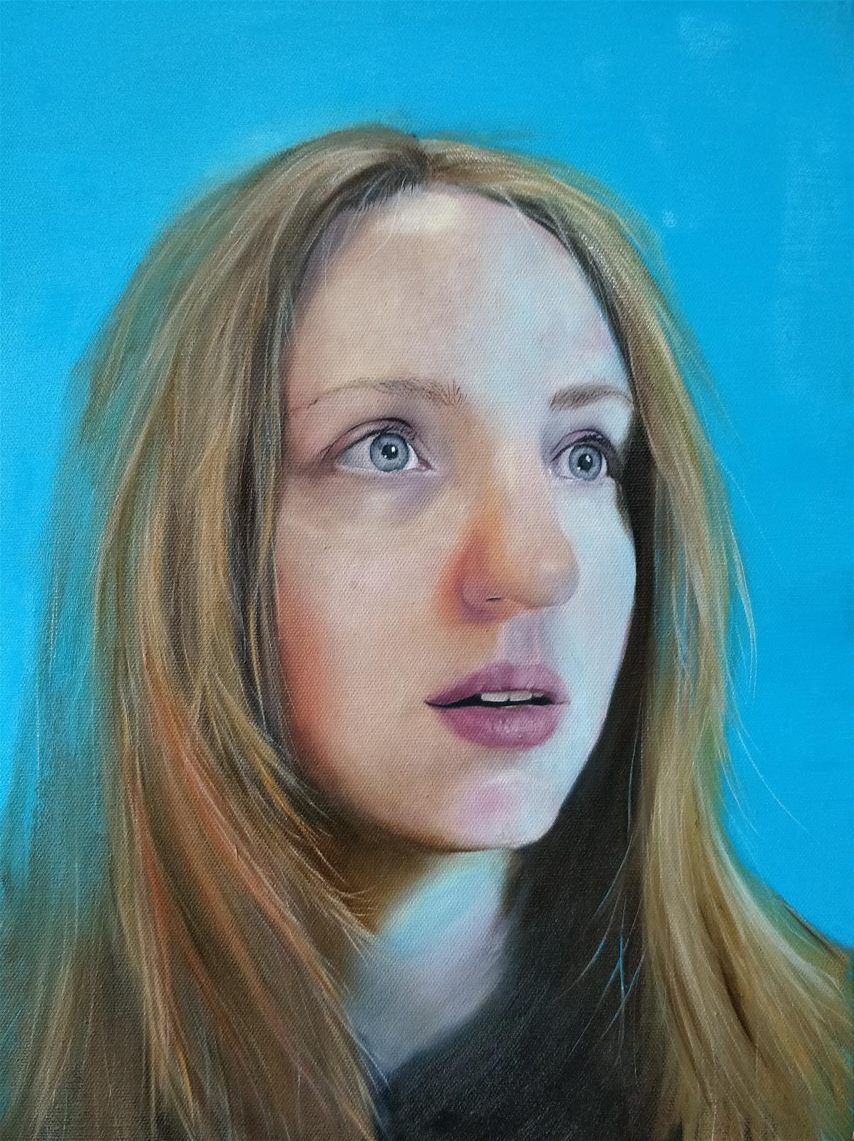 Self portrait with a blue background