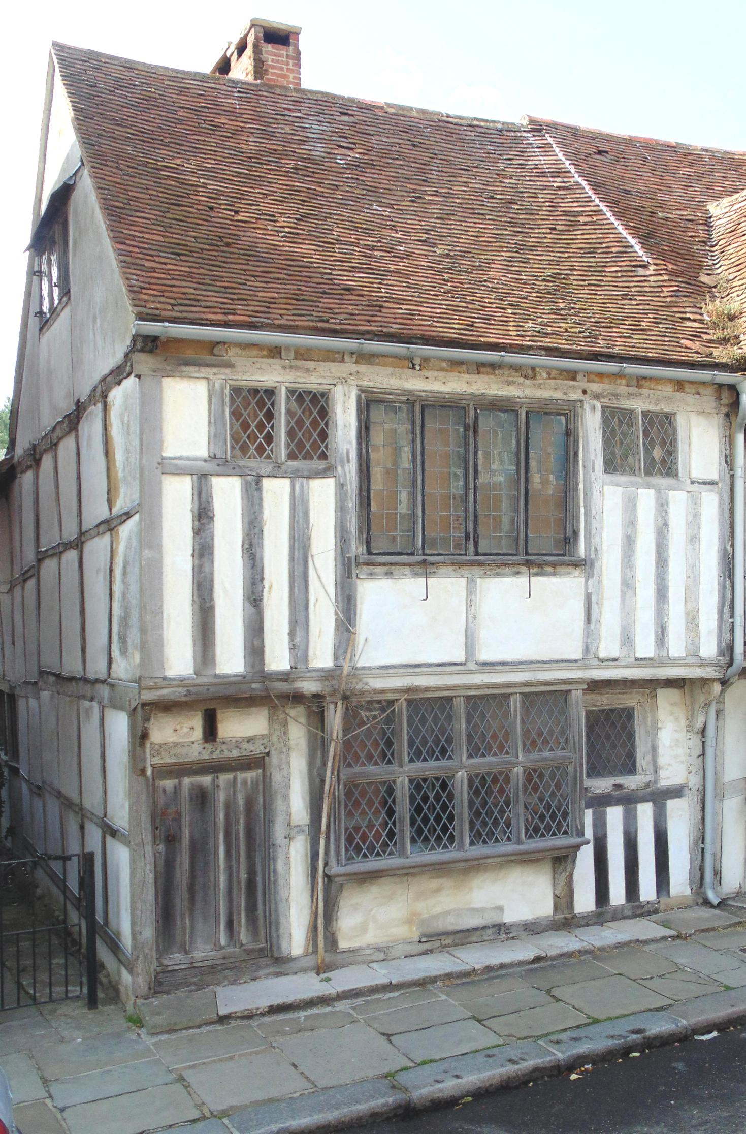 "<span class=""h3"">House and Former Mortuary.</span> Step through the wee door at 135 All Saints Street and journey back in time to another forgotten and truly magical world. This 16th century merchant's house and one of the most complete Tudor houses in Hastings Old Town, which underwent a unique and extensive restoration programme from 2006 -2011 to create the atmospheric dwelling you will see today.  The owner, Alastair Hendy, has taken it back to how it may have looked when first built, carrying out major structural repairs throughout, meticulously restoring every surface and internal fixture - yet reinventing the dust of history. Also emphatically autobiographical, the house challenges the conventions of the traditional restoration make-over and Tudor interior, and looks beyond each room's constraints and into its more conceptual and imaginative possibilities.  This magical house lit by candle light, along with its secret garden filled with giant plants, is an experience like no other. Come and step into the pages of a Grimm's Fairytale – you'll be amazed.   <span class=""h3"">Old Town Mortuary</span> The house has some secrets of its own, for up until the 1950s the rear wing was used as an undertaker's workshop, cadavers being stored in the adjoining cellar room. Two elderly Hastings fisherman have recently recounted their memories about when as boys they would come to The Wilderness (as the area behind upper All Saints Street was known then) and peer through the back windows of the house to spot the bodies laid out, then run away. Entry: £3 per adult, £2 per child (under 16). Donation to Old Hastings Preservation Society.  www.aghendy.com"