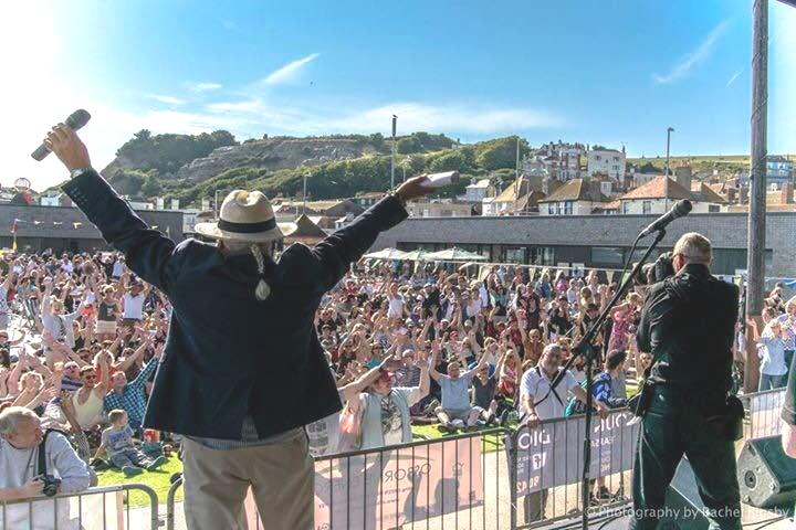 "<span class=""heading"">Saturday</span> Bands start at 1.30 pm including Rhythm Fields, The Rocking Ambassadors, Dead Calm, Local Heroes and The Blues Brothers Show.  <span class=""heading"">New this year</span> At 3.30pm we will be asking everyone who has come wearing Beach Concert t-shirts ""Through the ages"" ! to gather and parade around the site – Lets see how many years we can cover with a prize for the oldest shirt there!!  <span class=""heading"">Sunday</span> Music starts at 1pm with DJ Wendy May and follows on with Alibi, Brent Hutchinson Blues, Pete Presscot Band with The Sgt Pepper Album ""LIVE"" and we finish the weekend with The Rockit Men  Collections in aid of Hastings RNLI, Pett Level Rescue and Hastings Sea Cadets will be taking place on site and around town. This is a free event so please give generously.    We have limited seating so why not bring a deckchair or rug and get comfy for the afternoon.    Licensed Bar, Catering and more on site (ALL PROFITS from these go to the charity collection).   No dogs allowed (sorry) and no glass or alcohol can be brought onto The Stade.   With many thanks to all our generous sponsors who are supporting us again this year.    Another High Street Traders Event."