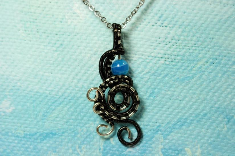 Wire pendant with blue agate bead