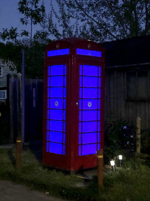 This phone box has been lit up in blue to thank the NHS