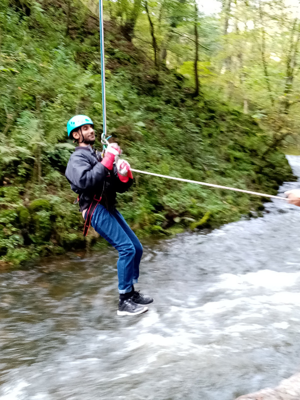 Adeel abseiling with Open Country in 2019