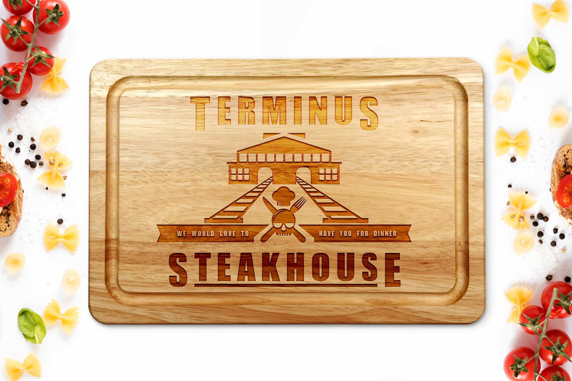 Terminus steakhouse chopping board on a white worktop