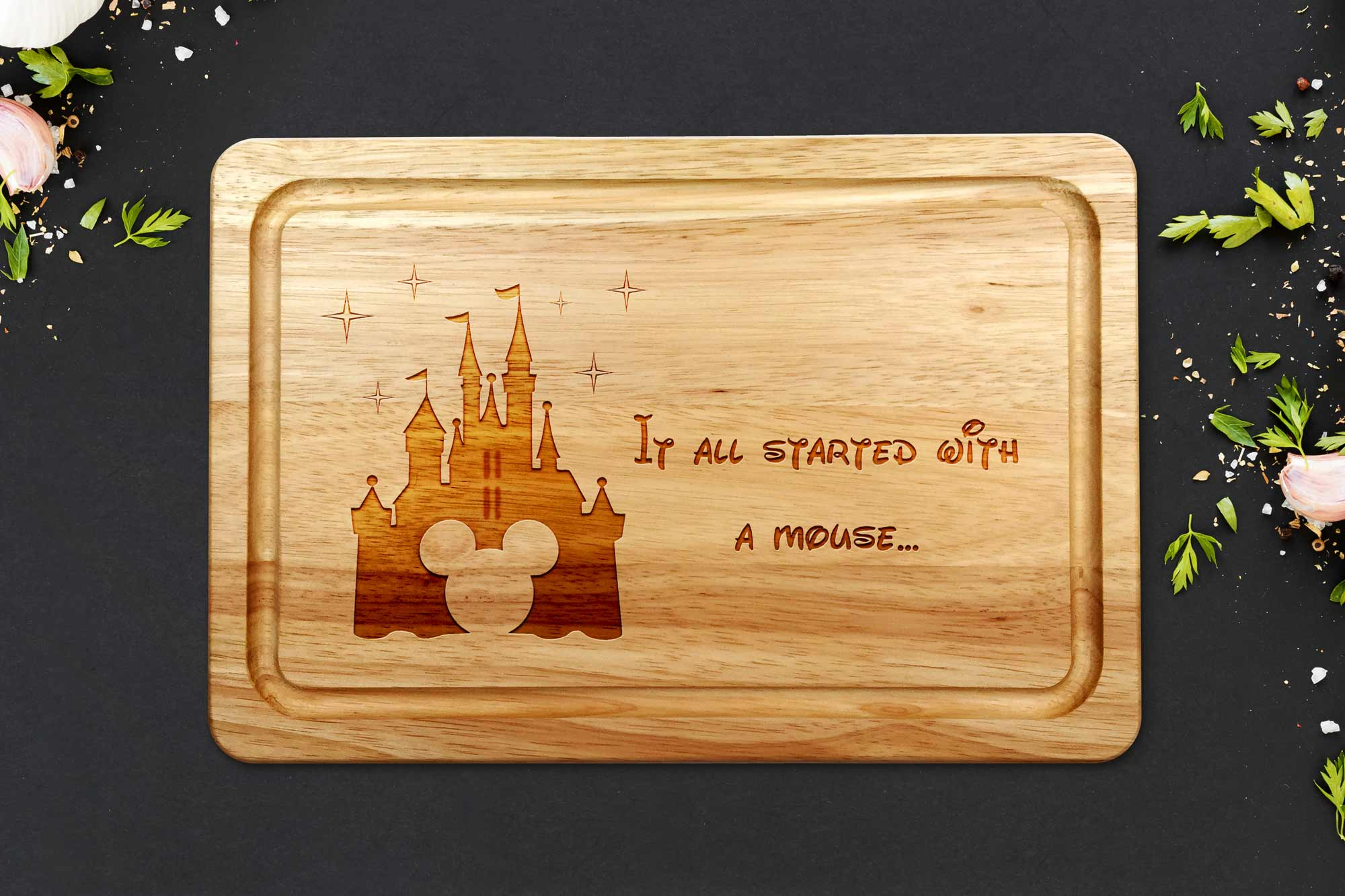 it all started with a mouse chopping board on a dark work surface