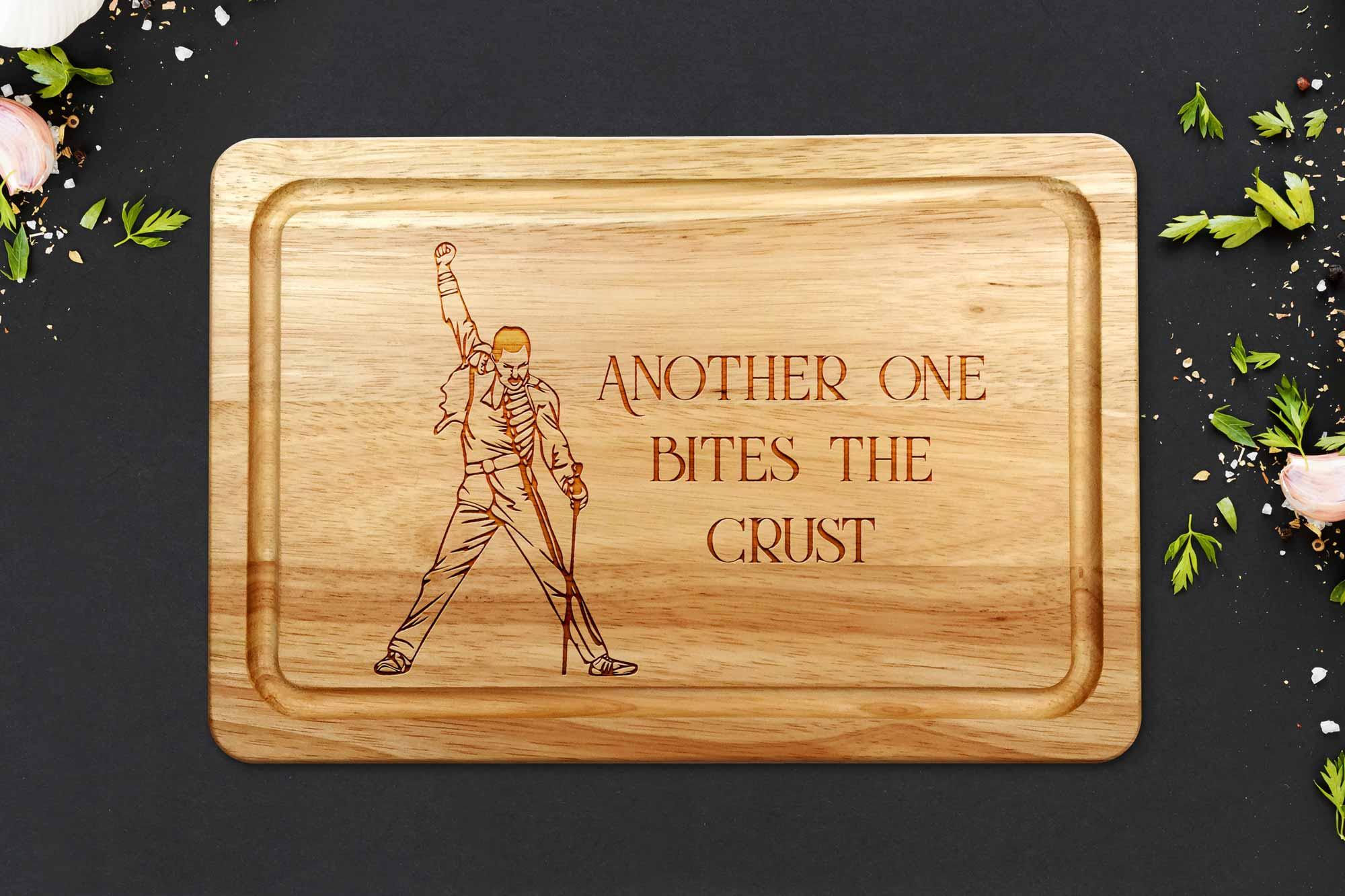 Freddie Mercury chopping board on a dark worktop