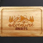 Adventure Awaits Chopping Board on a grey worktop