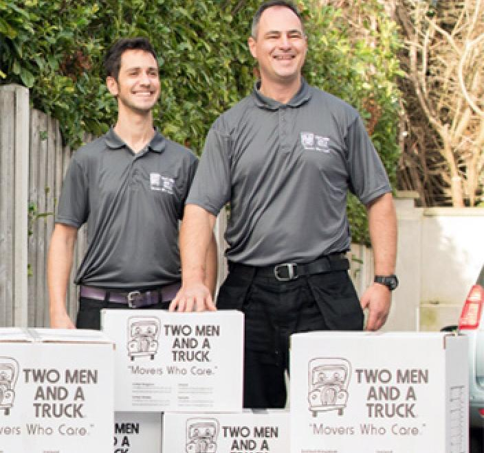 Men in front of moving boxes