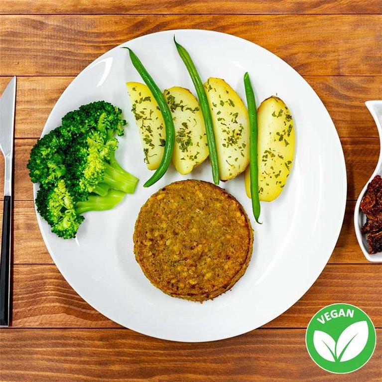 Burger vegana de lentejas y arroz integral con patata asada