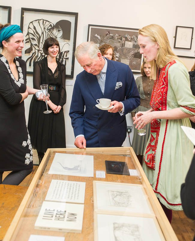 Illustrator Louise Yates shows HRH The Prince of Wales the original artwork for 'Dog Loves Books'