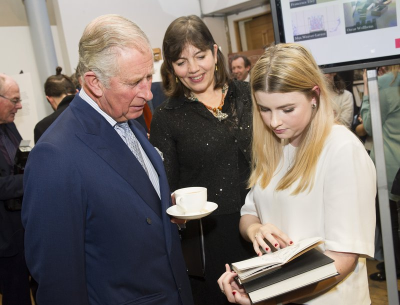 HRH The Prince of Wales and Catherine Goodman look at Foundation Year alumna Isabeau Gervais' sketchbook