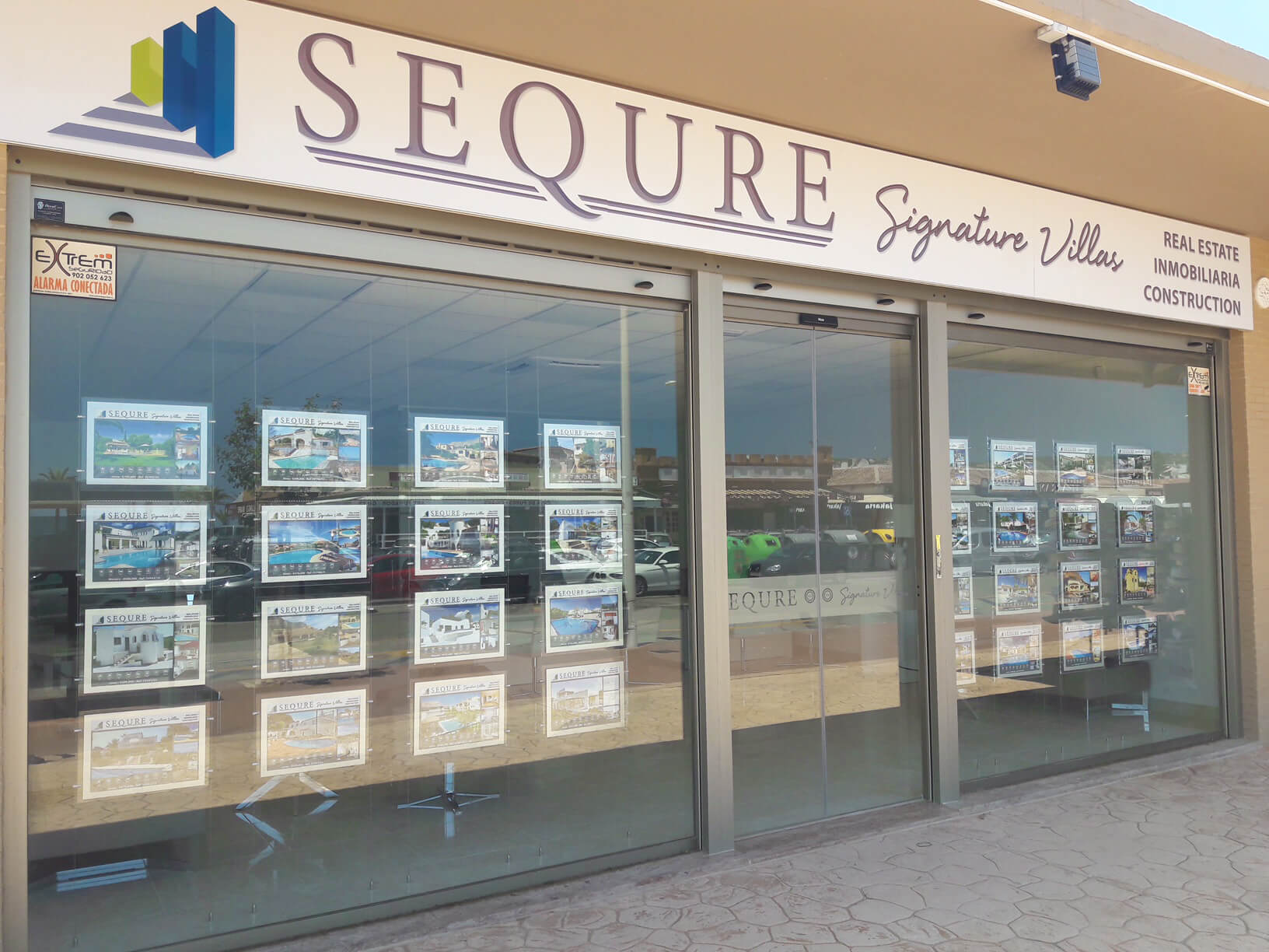 outside costa blanca north office. A window display of properties and villlas in the costa blanca north