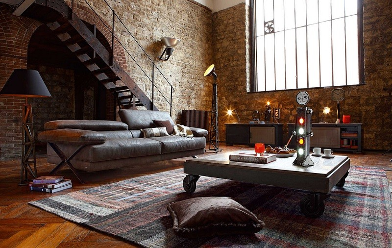 new york style loft with brick walls a large leather sofa next to robotic and machinary inspired coffee table, lights and clocks