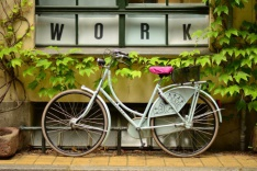 "Bike used for a student summer job with the word ""work"" above it"