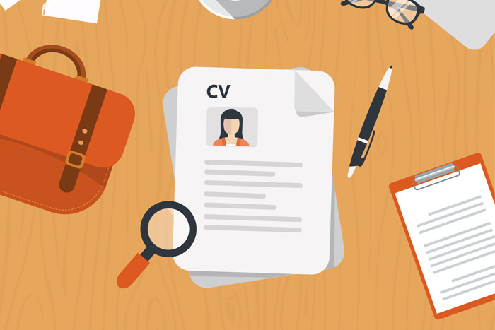 A graphic showing a CV on a desk