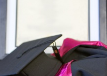 photo of a graduation gown and cap