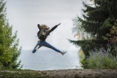 student jumping for joy