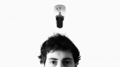 Light bulb above a young person's head representing using your initiative