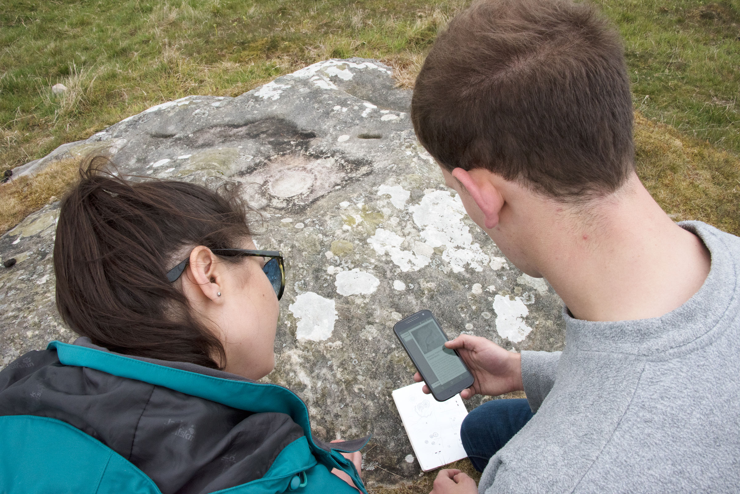 Using the Rock Art CARE mobile app (Photograph by Aaron Mazel)