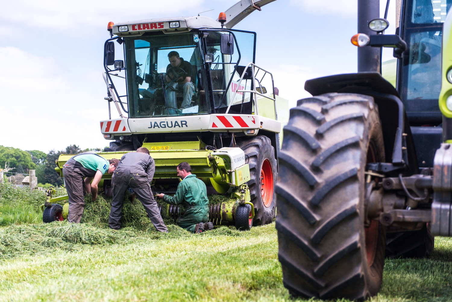 students and lecturer working on a harvester