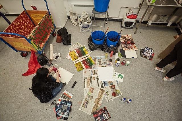 female art student sat down being creative