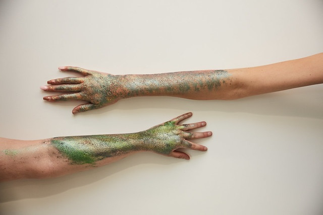 two arms parallel with paint