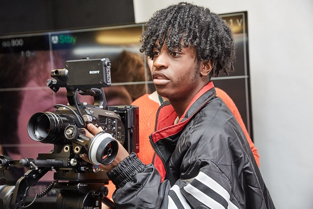 male film studies student holding camera