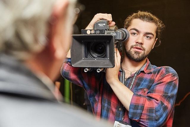 male film study student holding camera