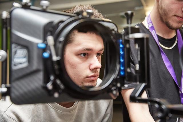 film studies student in camera lense