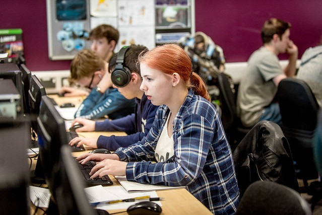 several games development students on computers