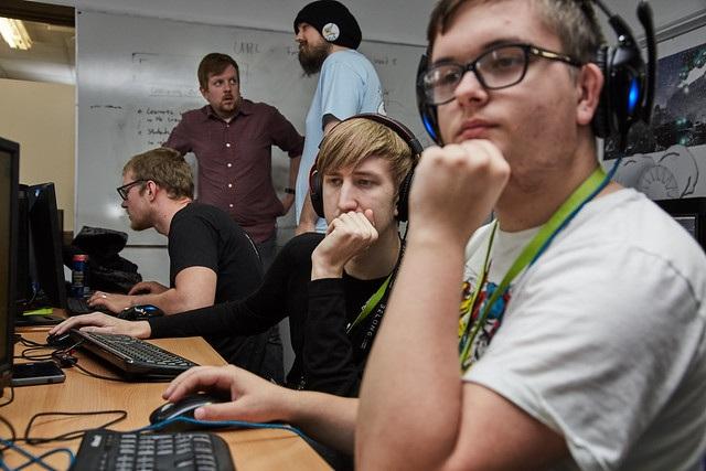 games development students sat behind their desks