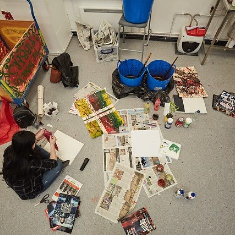female art student sat down being creative