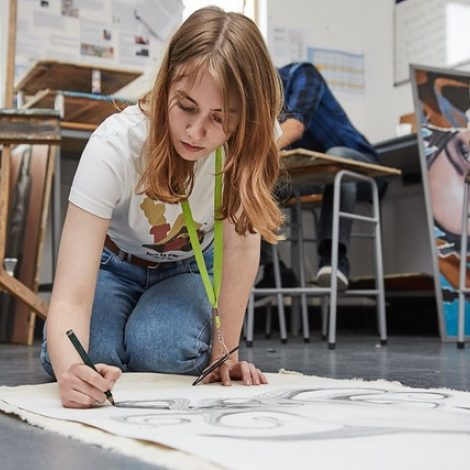 female art student drawing