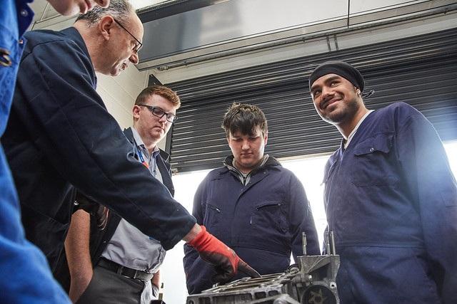 lecturer talking to automotive maintenance students