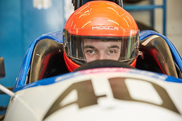 motorsport engineering student sat in race car
