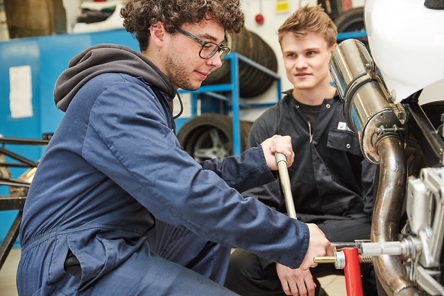 motor vehicle students working on a car