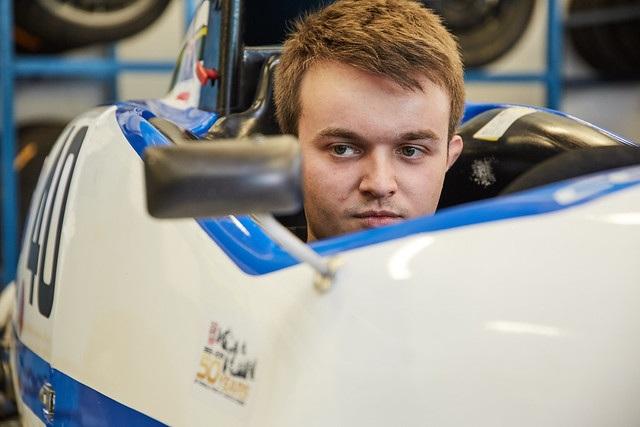 Motorsport Engineering student sat in race car