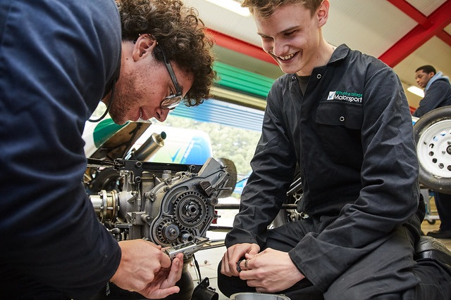 two male motorsport engineering students working together
