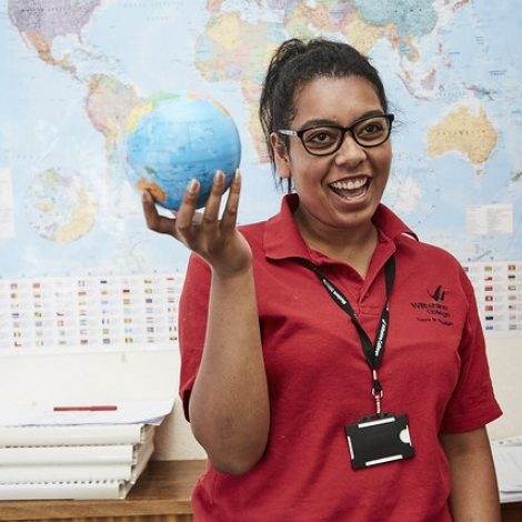 travel student holding a globe