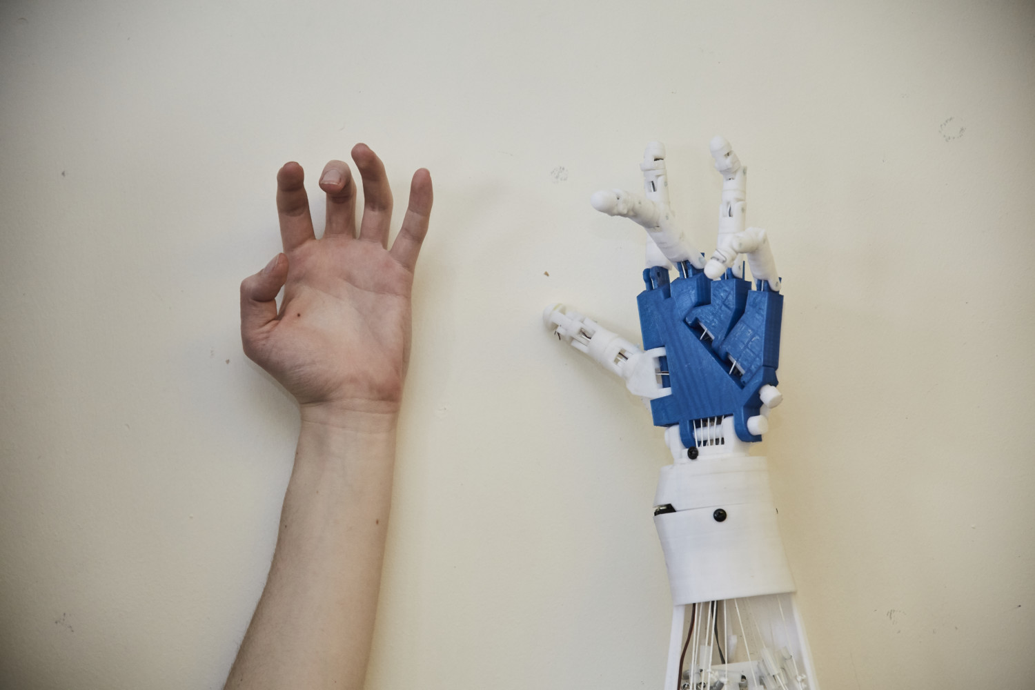 hand against a robotic arm
