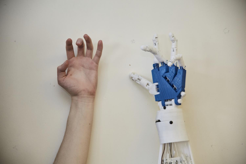 hand against a robotic arm