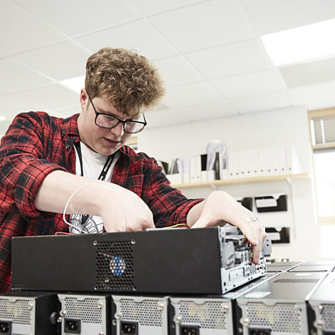 computing student working on a computer