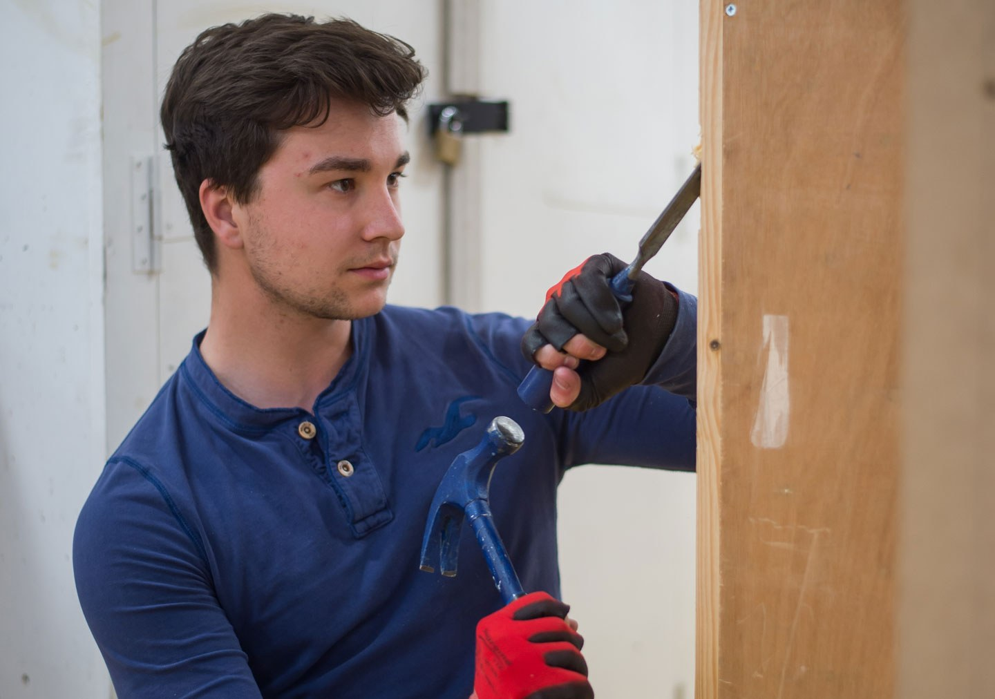 Student using a hammer and chisel