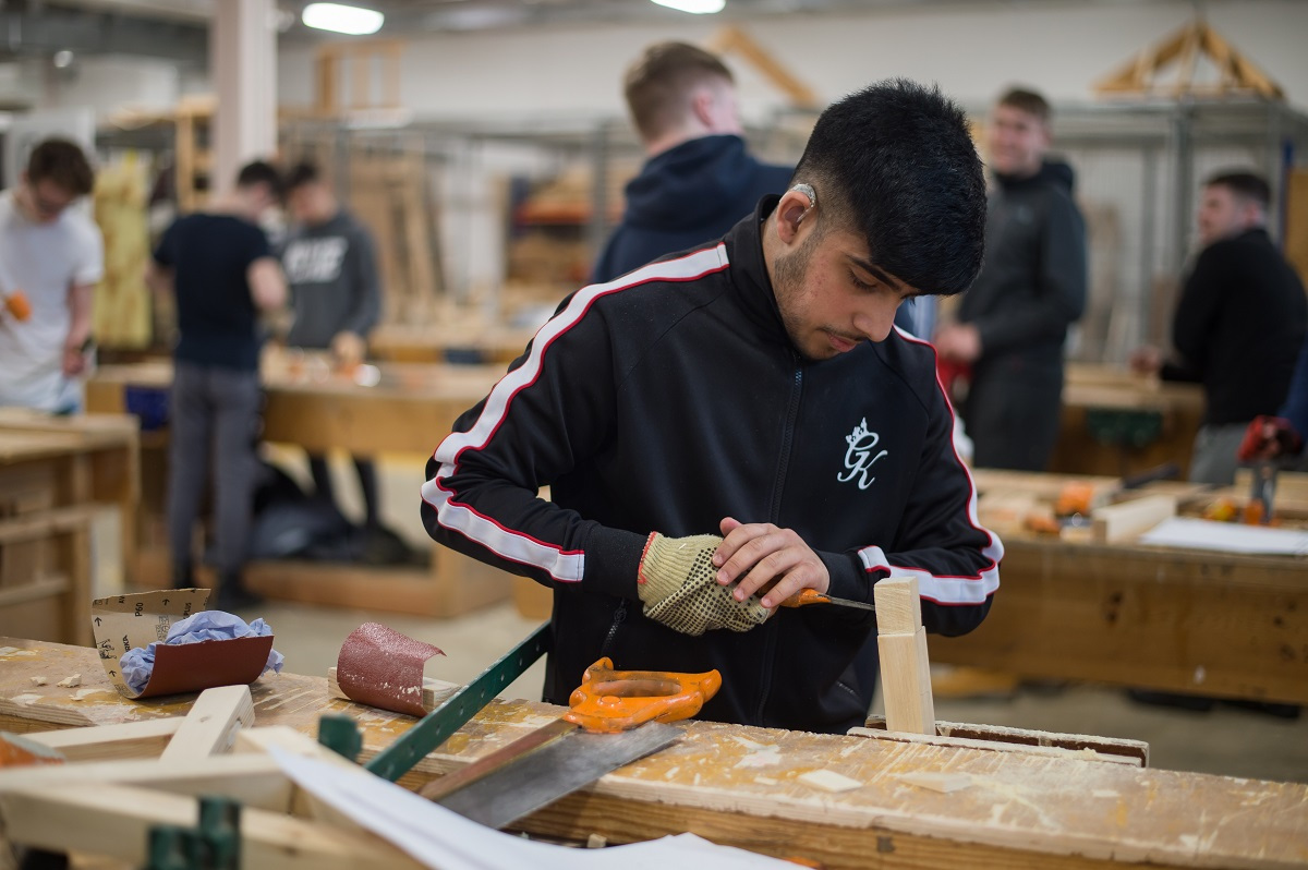 Carpentry Student working with wood in the workshop