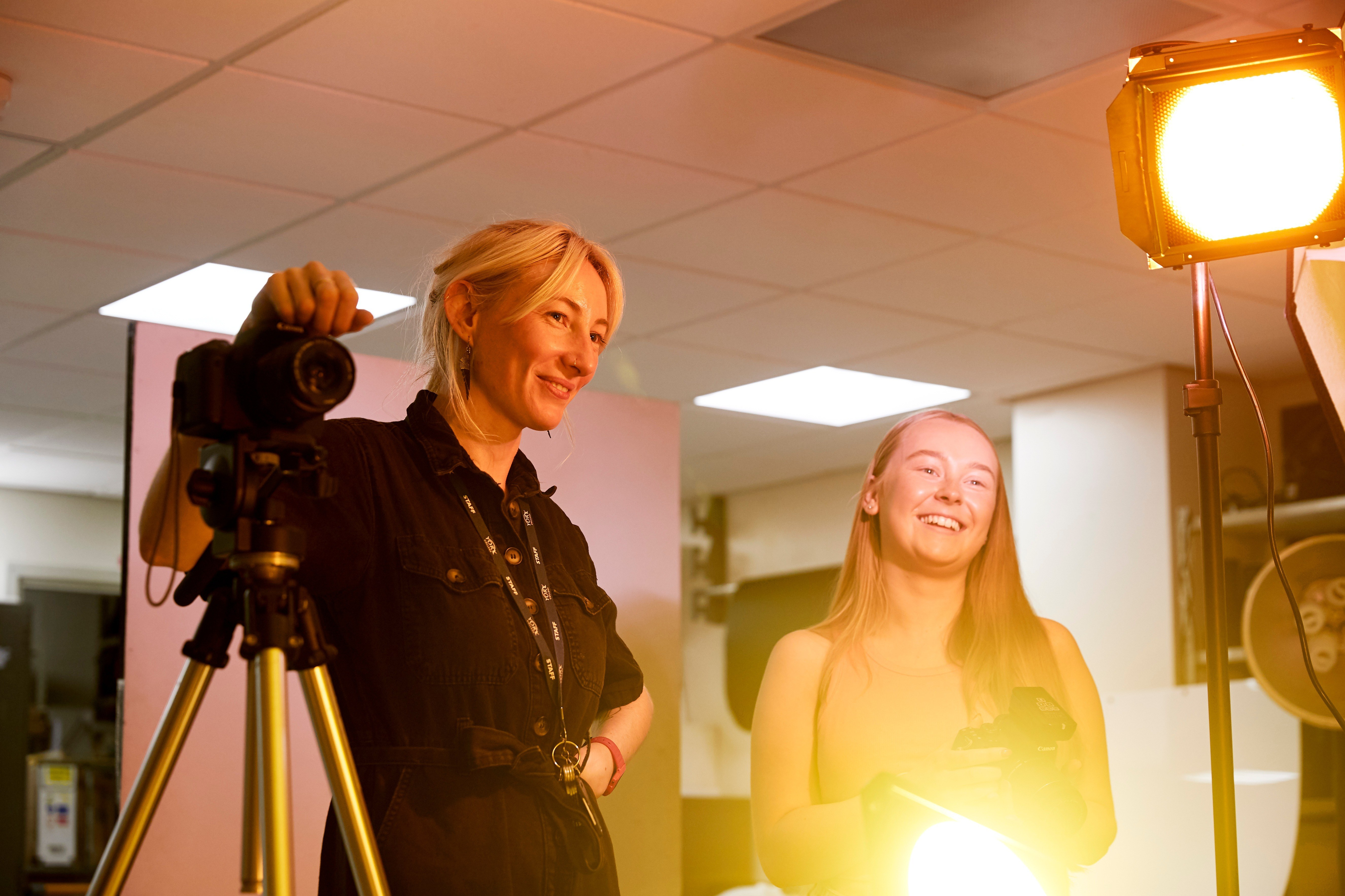 Clare Natress and student in photography room chatting