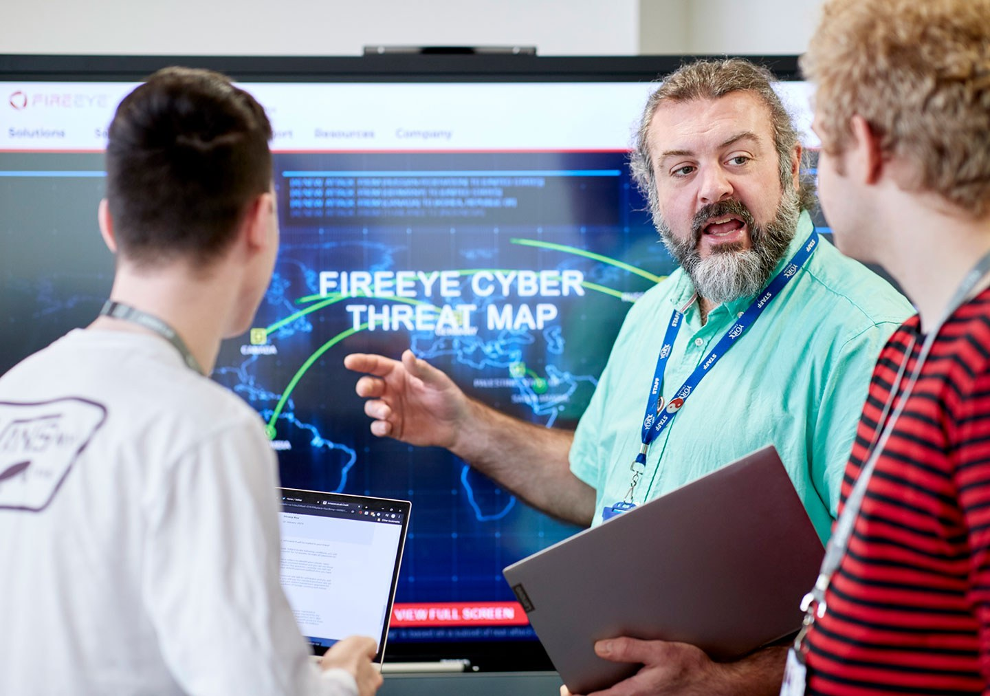 Cybersecurity students being taught by tutor