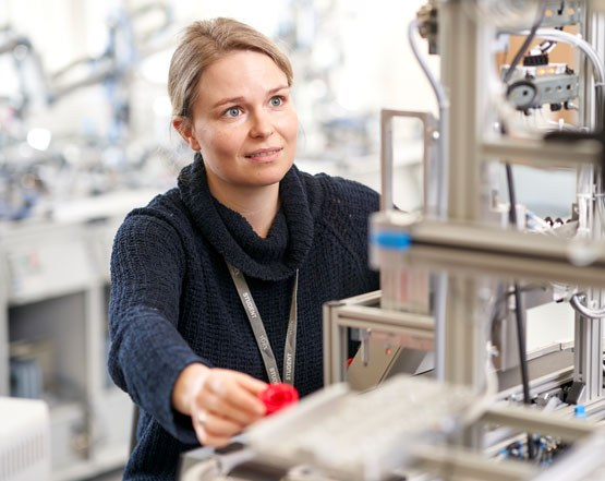 Engineering student using dummy production line